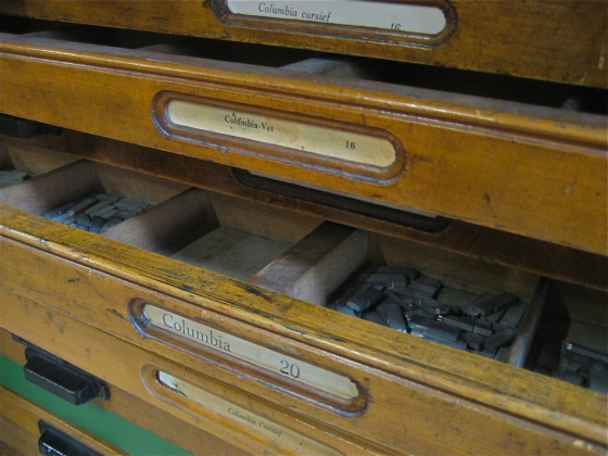 One of many drawers filled with type.